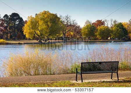 Empty Park Bench By A Lake In Fall - Denver