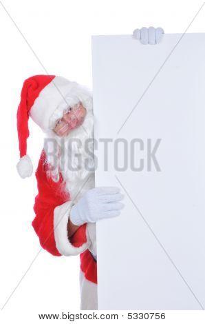 Papai Noel com um sinal em branco