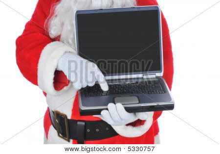 Santa Claus Holding A Laptop Computer
