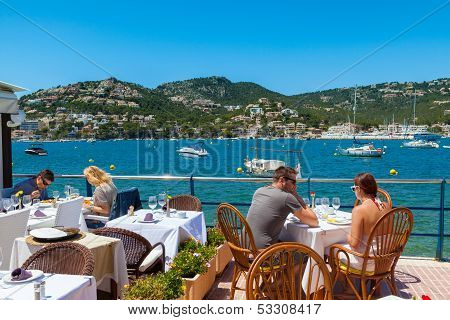 Tourists Having Lunch In Puerto De Andratx, Majorca