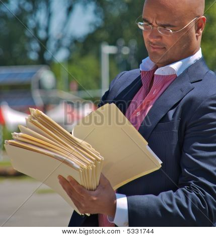 Businessman Looking Into Files
