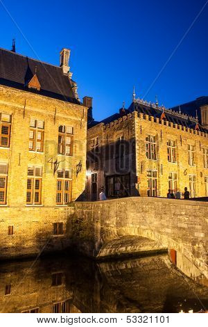 Night shot of historic medieval buildings along a canal in Bruges Belgium