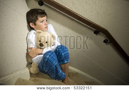 Sad And Depressed Boy In Corner