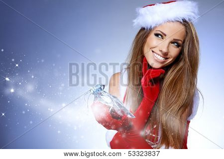 Christmas Santa hat isolated woman portrait hold christmas gift. Smiling happy girl on blue background.