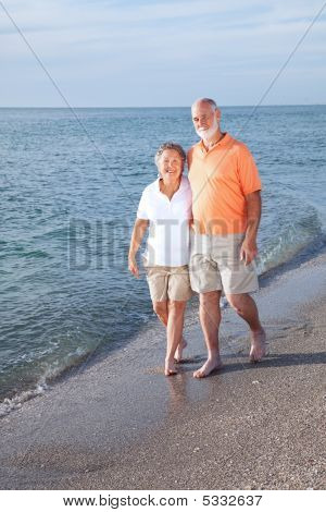 Seniors Stroll On Beach