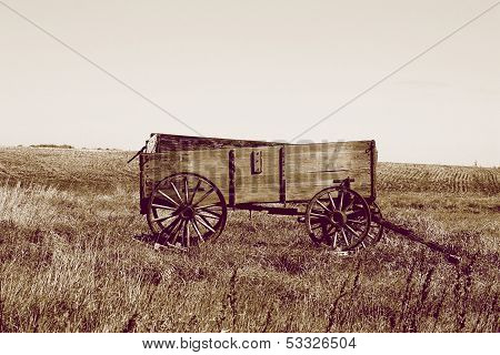Abandoned Grain Wagon in a Field in Sepia