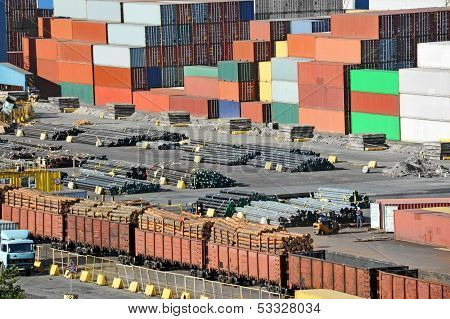 Container, lumber, pipe and train in port