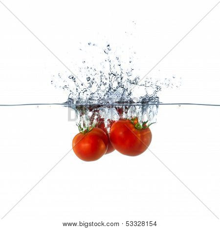 Fresh Red Tomato Fruits Sinking In Water