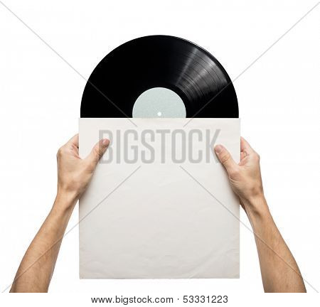 Hands holding vinyl record in a paper case