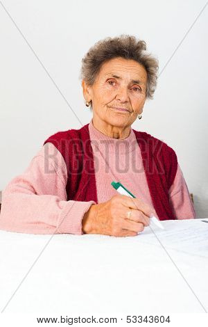Elderly Lady Signing Contract