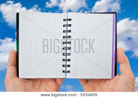 Spiral Notebook In Hands