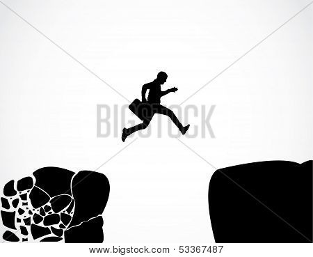 Businessman with a briefcase jumping reaching safety from an risky unsafe business environment