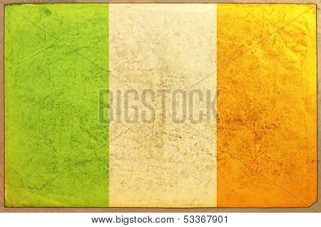Ireland Flag on aged paper texture can be used as background