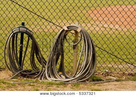 Hoses At Baseball Field