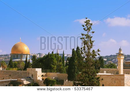 The Holy City of Jerusalem is lit by the morning sun.  Golden Dome Mosque of Caliph Omar