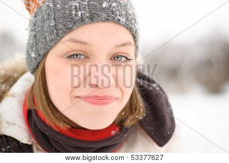 Girl's Face In Snow