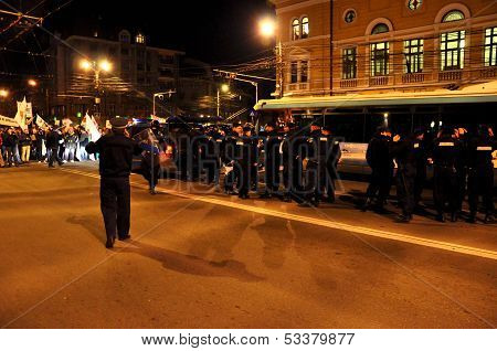 Special unit policemen fighting against peaceful protesters