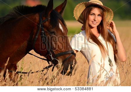 The woman on a horse in field