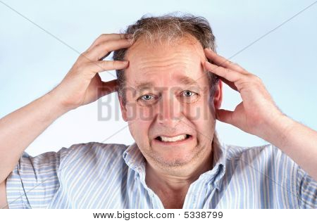 Man Suffering From A Headache Or Bad News