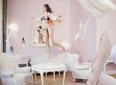 foto of levitation  - Levitating brunette beauty - JPG