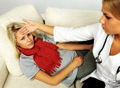 foto of high fever  - Female doctor checking sick - JPG