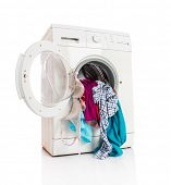 foto of dirty-laundry  - Washing machine with clean linen on a white background - JPG