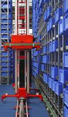 stock photo of crate  - Automated storage warehouse with blue plastic crates - JPG
