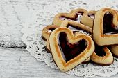 image of shortbread  - Heart shaped shortbread cookies in a circle on a rustic background - JPG