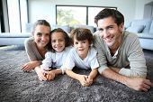 image of daddy  - Family at home relaxing on carpet - JPG