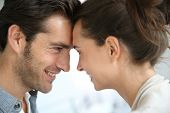 picture of forehead  - Profile of loving couple looking at each other - JPG