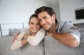 stock photo of sofa  - Couple at home relaxing in sofa - JPG