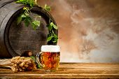 stock photo of keg  - Beer keg with glass of beer and blur background - JPG