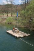 stock photo of raft  - A small river raft on a river near the Slovenian town of Planina - JPG