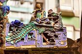 Porcelain Roof Chinese Figurines, Flutist,  Man Mo Temple  Hong Kong