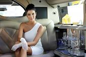 pic of limousine  - Beautiful smart woman sitting in limousine - JPG