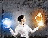 picture of intuition  - Image of businesswoman balancing with items in palms - JPG