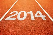 stock photo of happy new year 2014  - Number 2014 on athletics all weather running track - JPG