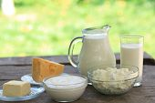 stock photo of curd  - Dairy products on wooden table selective focus shallow deep of field - JPG