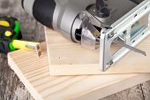 picture of fret  - electric fretsaw on a wooden table - JPG