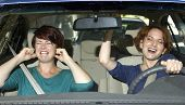 stock photo of annoying  - two women on a road trip inside a car - JPG
