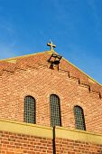 stock photo of protist  - detail of church against a bright summer sky - JPG