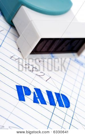 Blue Paid Stamp With An Invoice On White