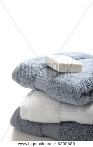 White And Blue Towels With Soap On White