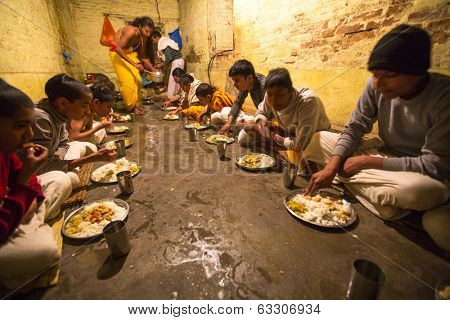 KATHMANDU, NEPAL - DEC 9, 2013: Unknown children during dinner at Jagadguru School. School established at 2013, to let new generation learn Sanskrit and preserve Hindu culture.