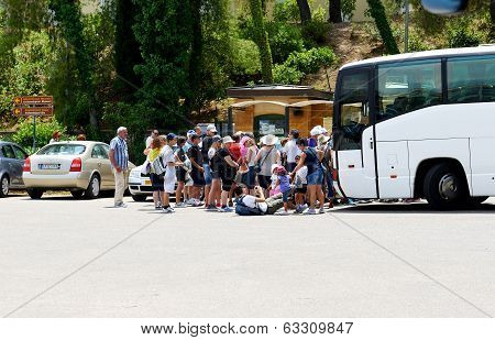 Olimpia, Greece - June 10: The Group Of Tourists Buying Tickets For Visit Of Ancient Olympia On June