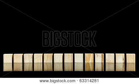 Row Of Thirteen Wooden Blocks