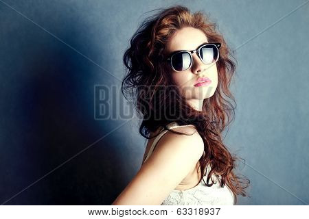 Portrait Of Young Beautiful Woman In Sunglasses.