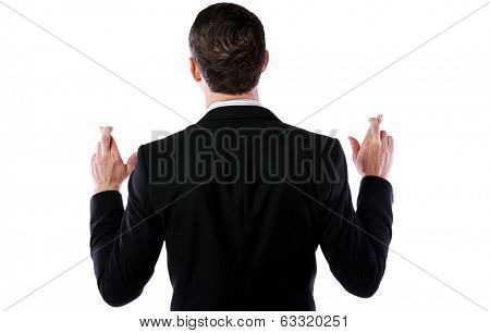 Back view portrait of a businessman making a wish isolated on white background