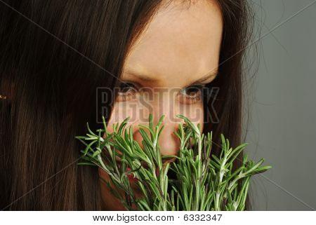 Girl Sniffing Rosemary