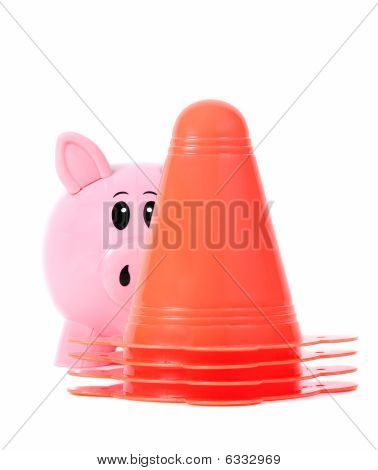 Piggy Bank Hides Behind Stack Of Orange Cones